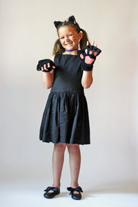 Child costume of cat ears and cat paws