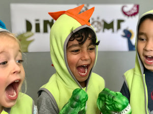 Children roaring like dinosaurs at a party