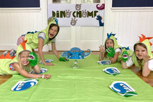 Load image into Gallery viewer, Children at dinosaur themed party with decorations