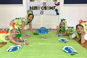 Children at dinosaur themed party with decorations