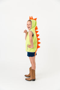 Green dinosaur vest with orange spikes on a child