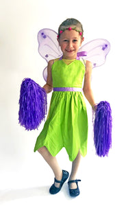 Child wearing a green fairy costume with wings
