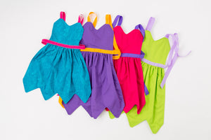Child aprons in blue, purple, pink, and green