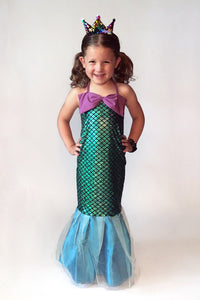 Child in a mermaid dress costume