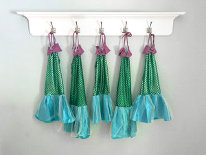 Mermaid costumes hanging prettily