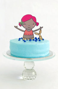 Mermaid cake topper on blue cake