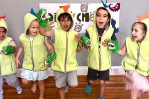 Dinosaur vest costume and dinosaur puppets worn by children