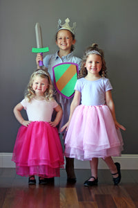 Kids in princess tutus and tiaras and a knight costume