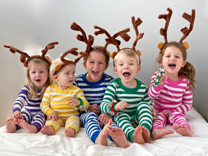 Children in reindeer antlers and striped pajamas