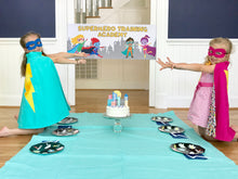 Load image into Gallery viewer, Children at a superhero themed birthday party eating cake