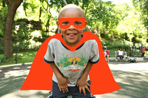 Superhero boy with red cape and mask