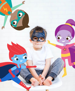 Boy in Batman mask, with superhero graphics