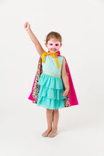 Load image into Gallery viewer, Child wearing a superhero cape with a white background