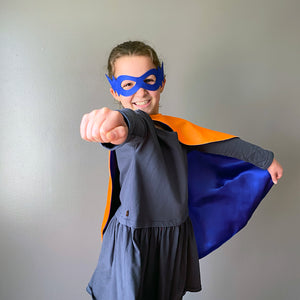 Superhero kid with cape and mask