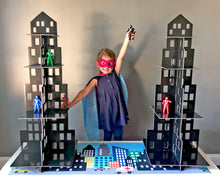 Load image into Gallery viewer, Girl in superhero costume playing with superhero toys