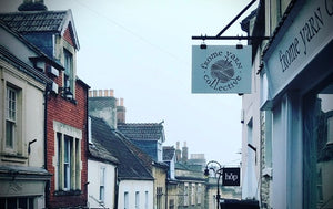 Shot of Frome Yarn Collective shop front and sign looking down Catherine Hill in Frome