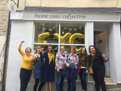Nicky and six other women stand outside Frome Yarn Collective on its opening day with their fists held high in a comradely salute.
