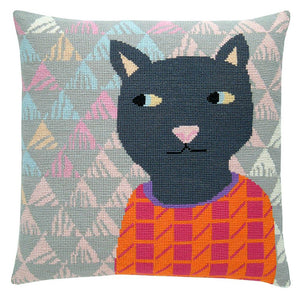 Cross stitch cushion cover with a grey cat wearing an orange and pink jumper on a background of soft grey, white, blue, pink and yellow triangles.