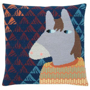 Cross stitch cushion cover with a grey horse wearing a yellow, green and orange jumper on a background of navy, rust, orange and pale blue triangles.