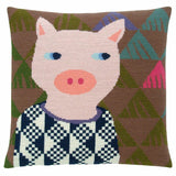 Cross stitch cushion cover with a pig wearing a jumper on a background of brown, green, teal, pink and purple triangles.