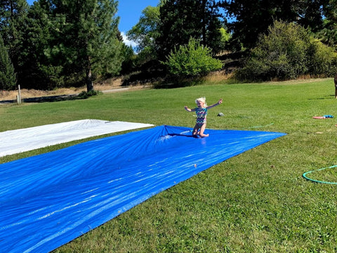 Pearl on homemade slipnslide at coral farms summer camp