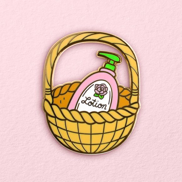 It Puts the Lotion in the Basket Pin