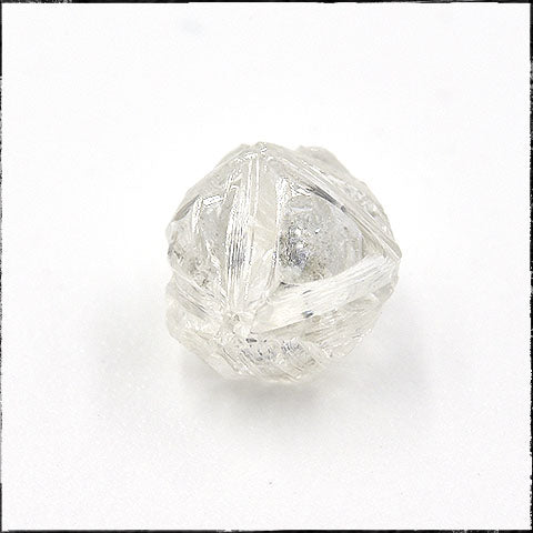 Rough octahedron crystal with ribbed edges