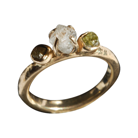 Three-stone rough diamond engagement ring