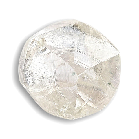 0.74 carat waterlike and gemmy raw diamond rhombododecahedron