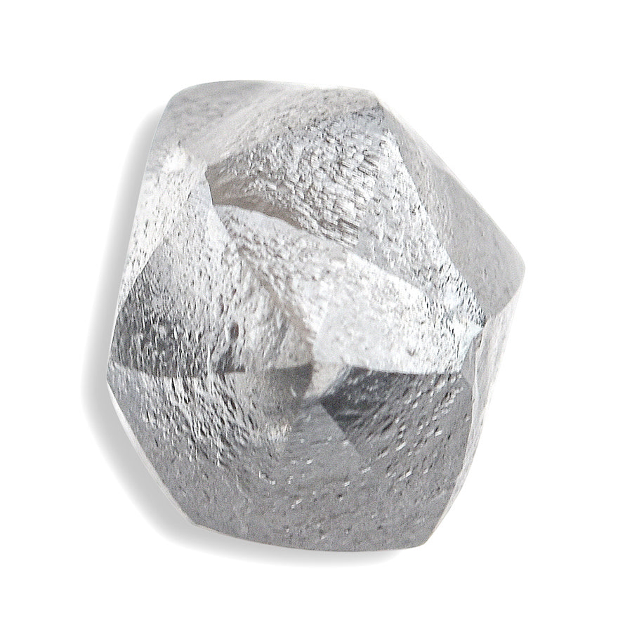 0.87 carat black and white raw diamond dodecahedron