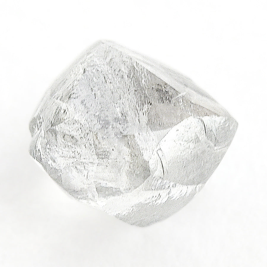 0.90 carat gleaming and colorless rough diamond dodecahedron