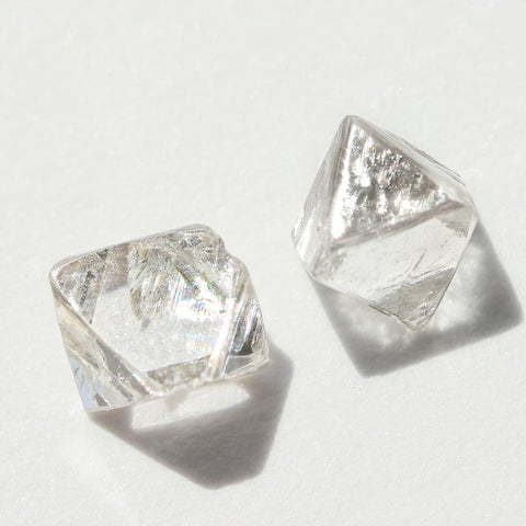 0.72 carat silver white raw diamond octahedron pair