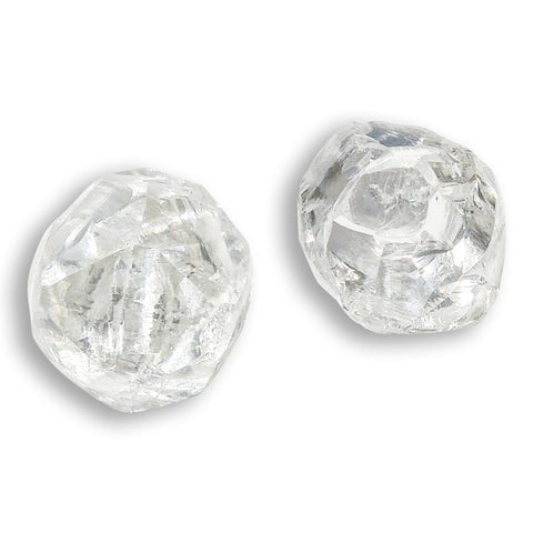 0.58 carat bright white raw diamond pair