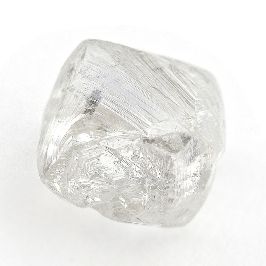 1.61 carat silvery and white rough diamond dodecahedron