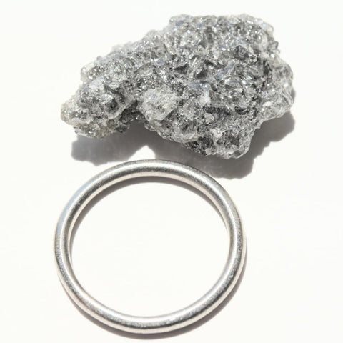 18.80 carat light grey sparkly raw diamond