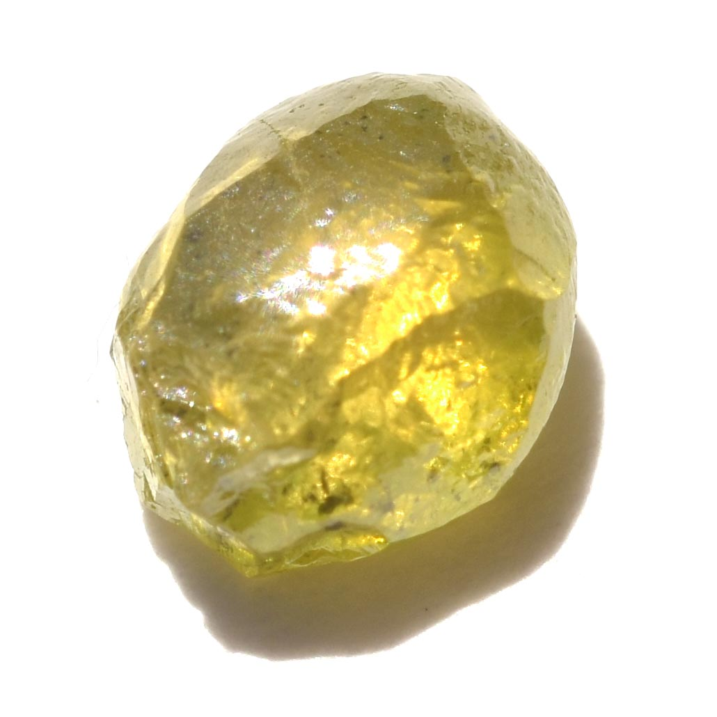 1.09 carat olive green freeform shaped raw diamond