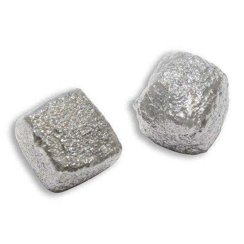 4.72 carat silver gray cubical raw diamond pair
