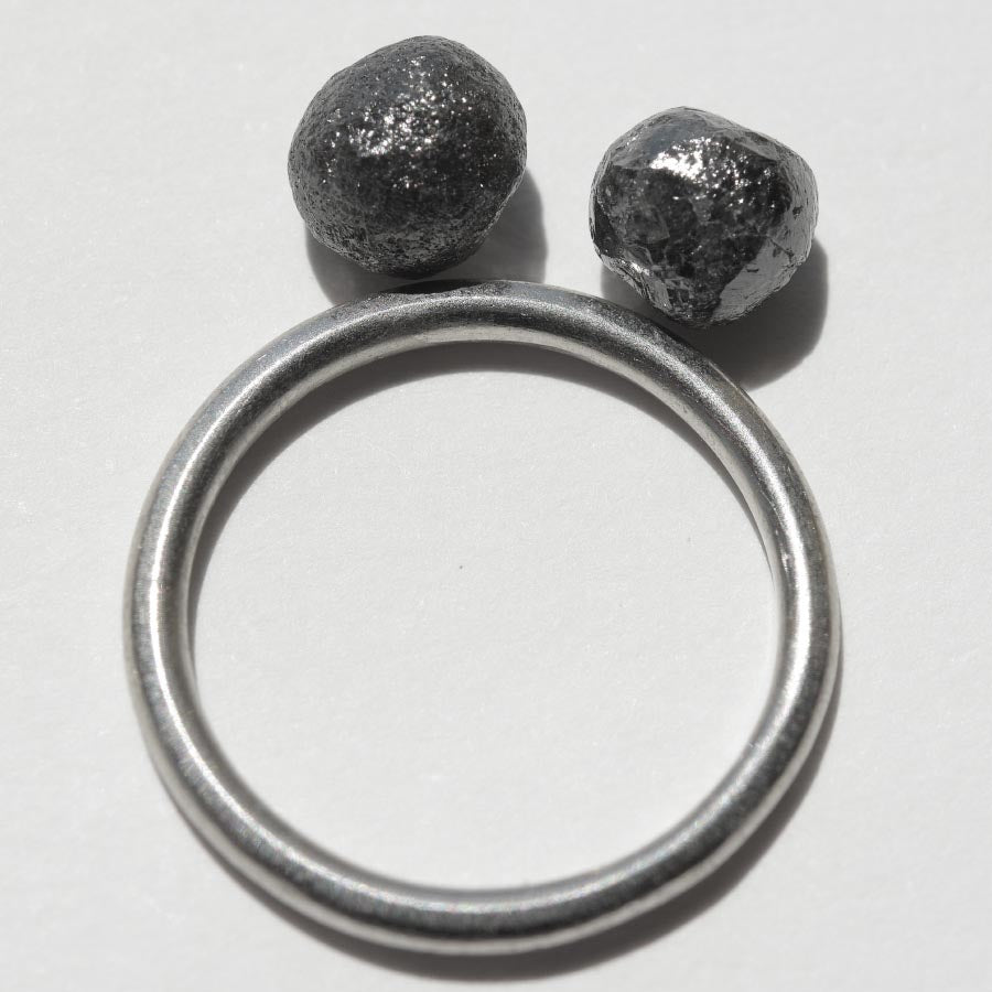 4.13 carat black round raw diamond pair