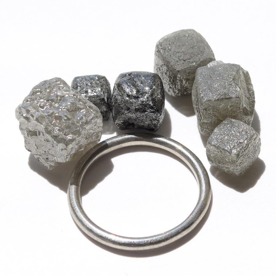 30.82 carat gray and black colored cube diamond parcel