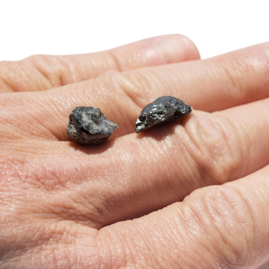 14.43 carat oblong black raw diamond pair