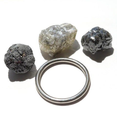 24.36 carat white, black and gray raw diamond parcel
