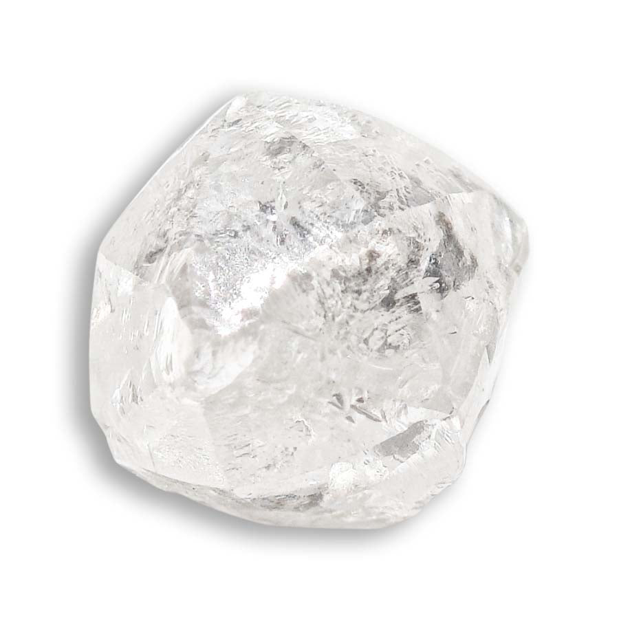 1.15 carat round and white raw diamond dodecahedron