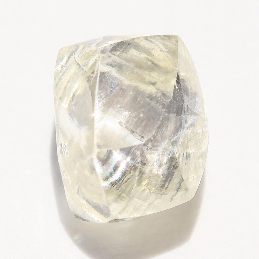 0.74 carat waterlike and yellow greenish rough diamond dodecahedron