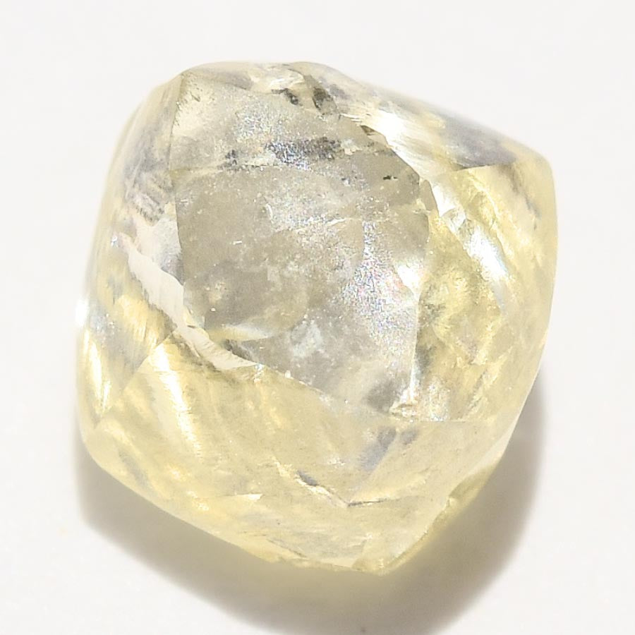 0.72 carat canary yellow raw diamond dodecahedron