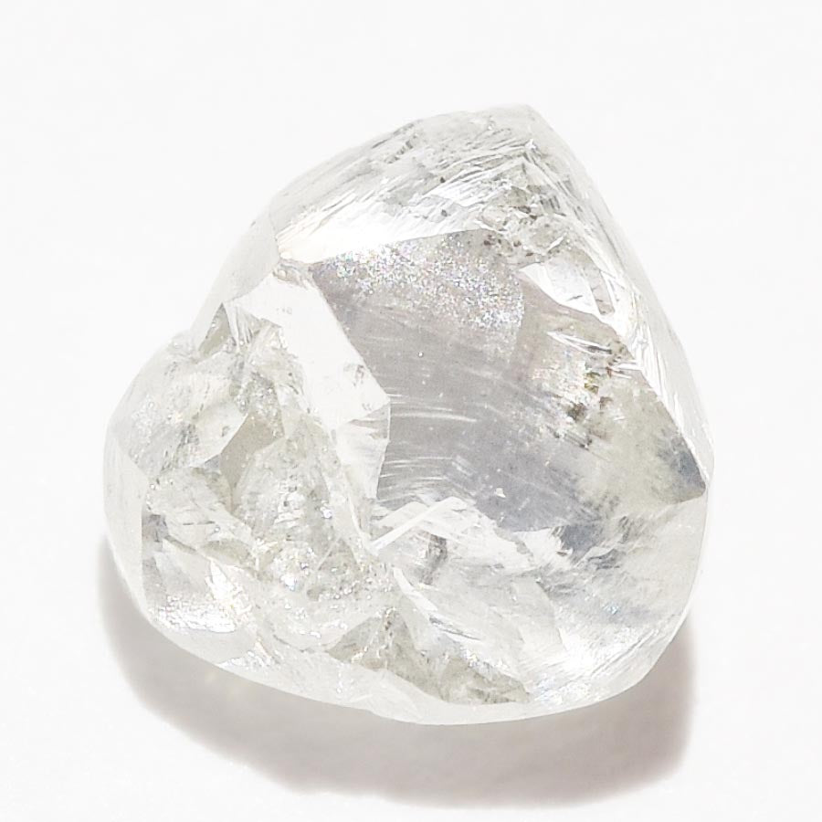0.64 carat triangular white raw diamond freeform shaped stone