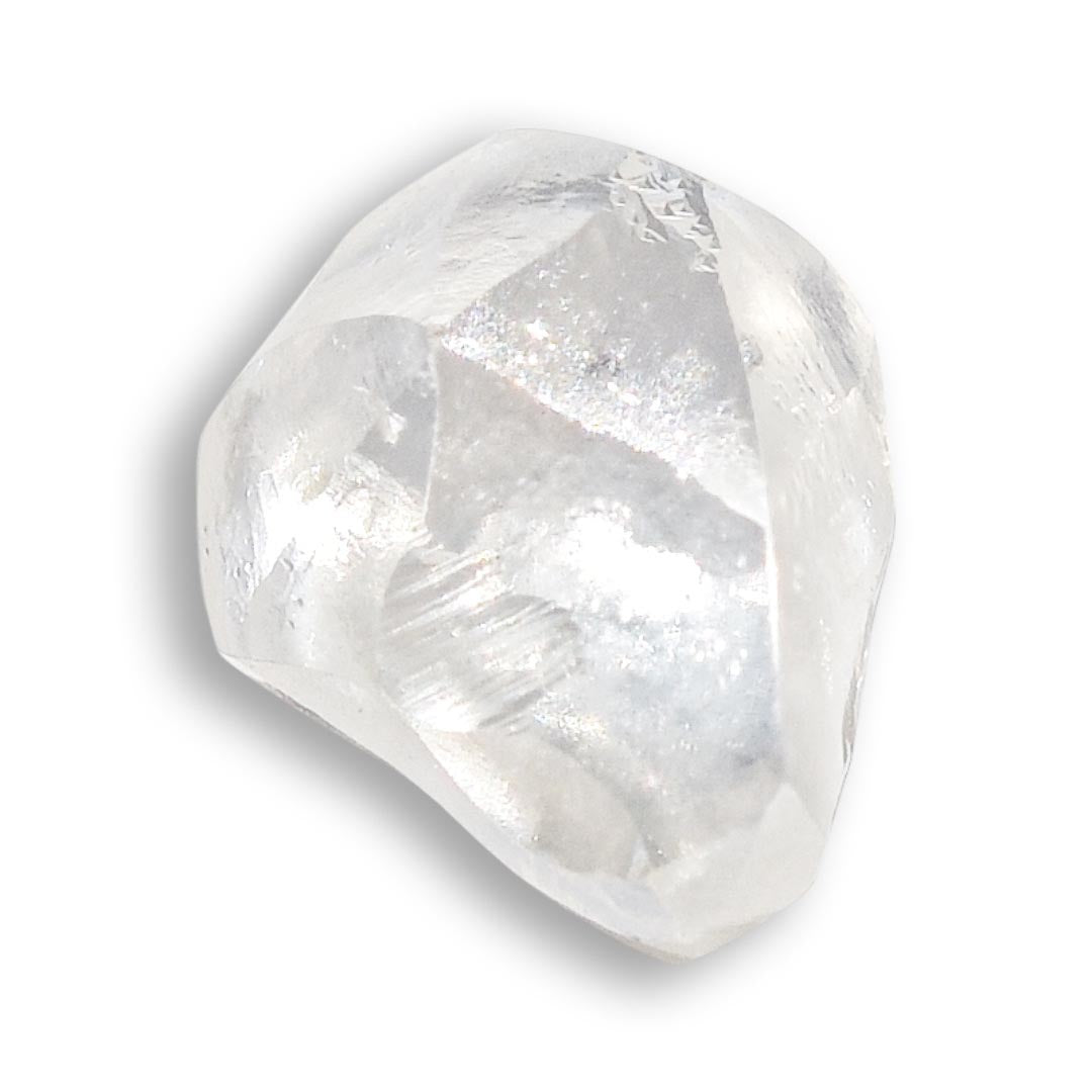 0.72 carat matte white freeform shaped raw diamond
