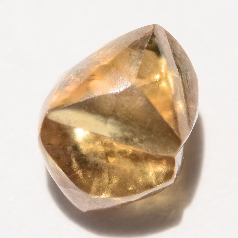 1.32 carat cognac colored rough diamond dodecahedron or maccle