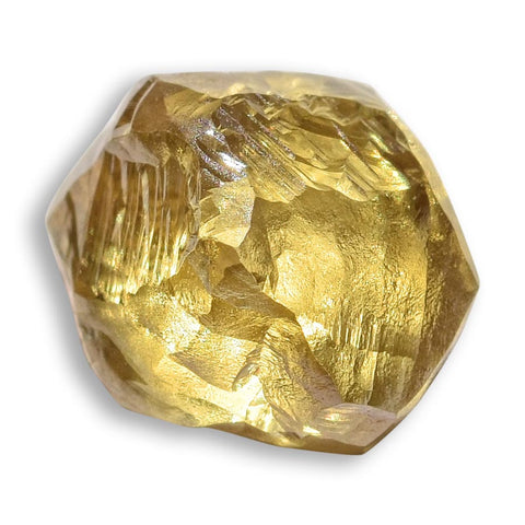 22.23 carat golden yellow freeform raw diamond parcel