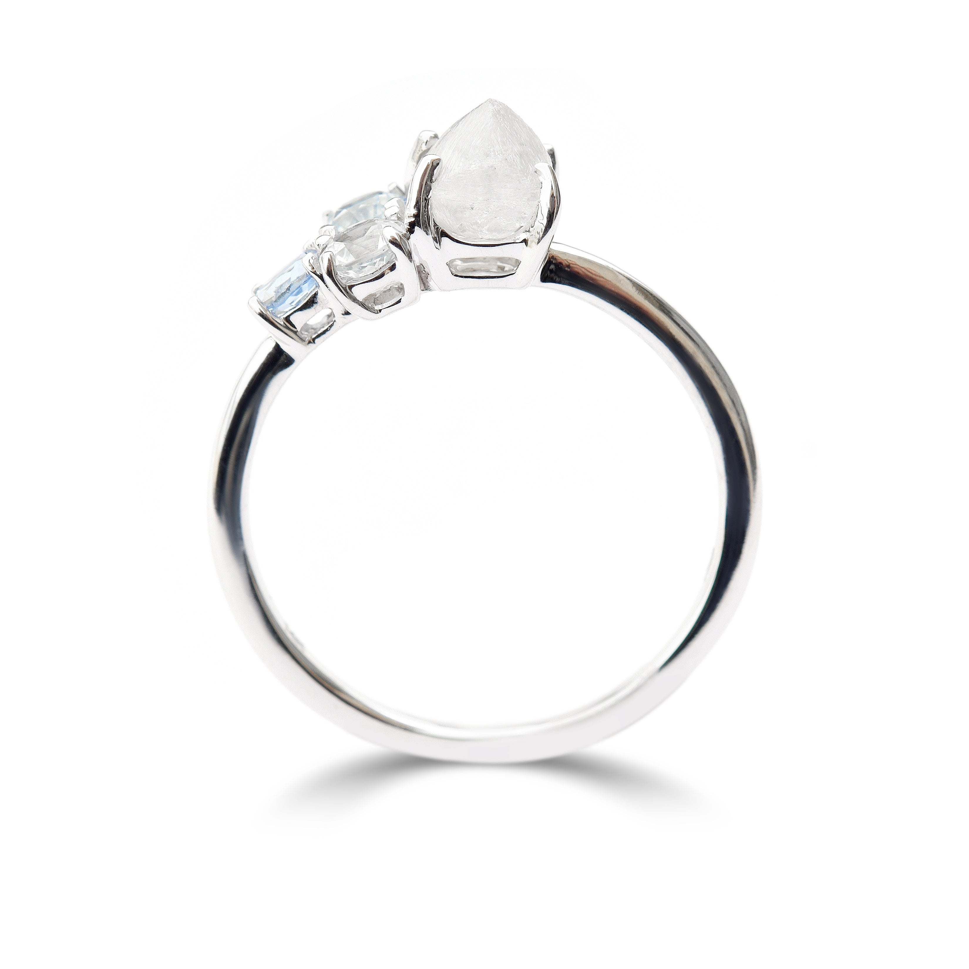 The Raziel ring - a customizable rough diamond and sapphire cluster engagement ring