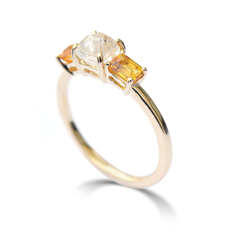 The Keren ring - a rough diamond engagement ring with two bright apricot sapphires